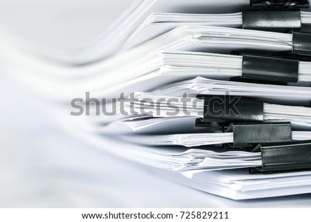 extremely close up  stacking of office working document with paper clip folder #725829211
