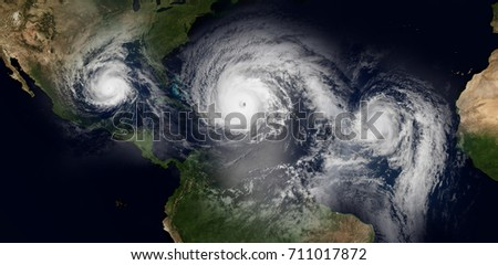 Extremely detailed and realistic high resolution 3d illustration of 3 hurricanes approaching the Caribbean Islands and Florida. Shot from Space. Elements of this image are furnished by Nasa.