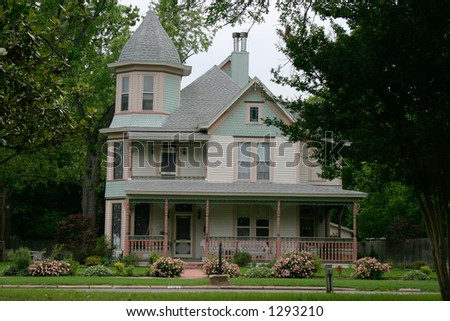 Extremely ornate and colorful restored Victorian era house in rural city