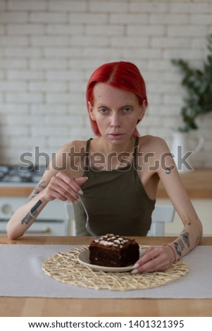 Extremely skinny. Extremely skinny woman with eating disorder thinking about eating chocolate cake #1401321395
