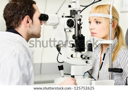 Eye doctor performing an eye examination