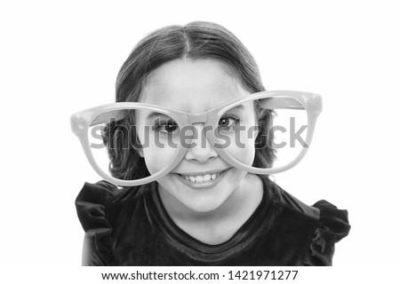 Eye exercises to improve eyesight. Girl kid wear big eyeglasses. Eyesight and health. Optics and eyesight treatment. Effective exercise eyes zooming. Child happy with good eyesight. Laser correction.