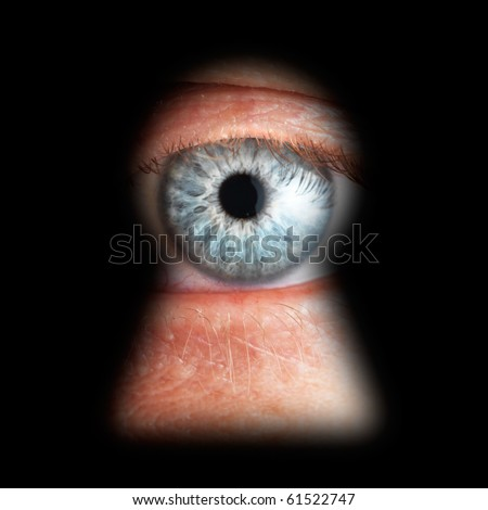 Eye in keyhole, isolated on black background - stock photo