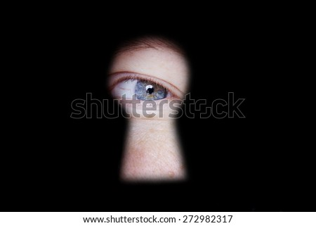 eye looking and spying at you through door keyhole