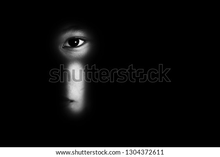 eye of boy through key whole, child abuse concept #1304372611