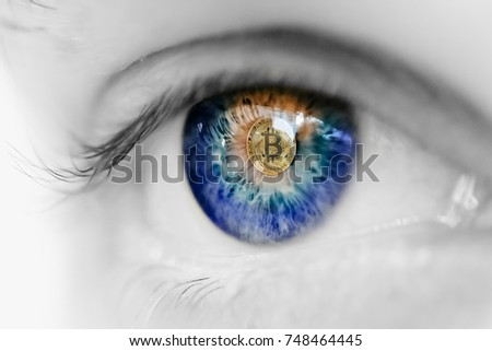 Eye of person with bitcoin coin logo in pupil