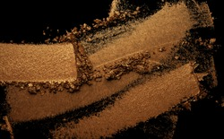 Eye shadow metallic brown terracota gold texture background black isolated