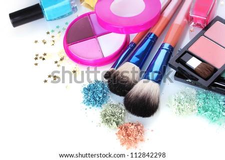 eye shadow, nail polish and make-up brushes isolated on white - stock photo