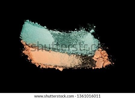 Eye shadow set multicolored blue and orange crushed powder smudged isolated on black #1361016011