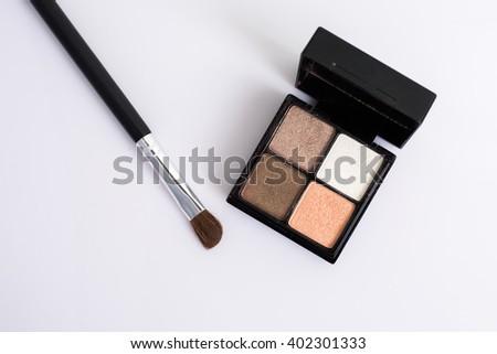 Eye shadow with brush on white background. #402301333
