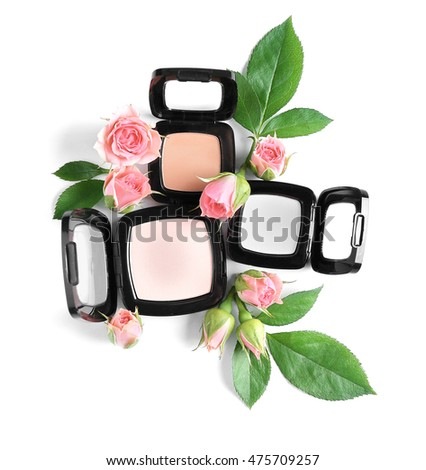 Eye shadows and flowers on white background #475709257