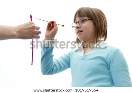 Eye vision therapy. Young girl at optometrist clinic #1019519554