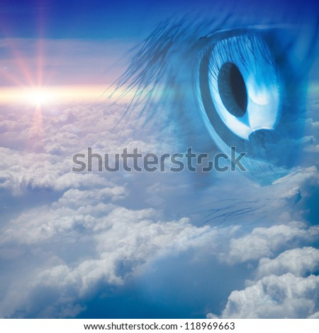 eye with blue sky white cloud background