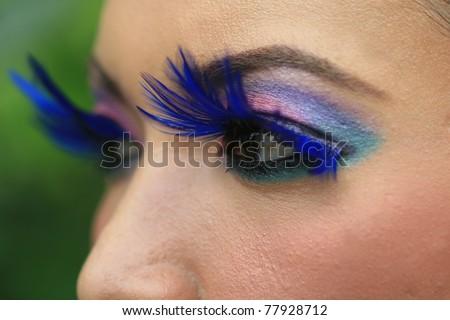 eye with fancy blue mascara