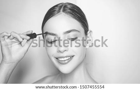 Eyebrow concept. Beautiful thick eyebrows, a vivid glance. Perfect eyebrows, make-up correction
