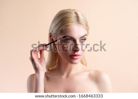 Eyebrow correction. Perfect natural eyebrows and eyelashes. Lush eyebrow. Natural make up. Beauty. Eyebrow and eyelashes close up