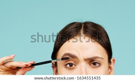 Eyebrows correction. Shape. Perfect natural eyebrows and eyelashes. Lush eyebrow. Natural make up. Beauty. Eyebrows and eyelashes close up
