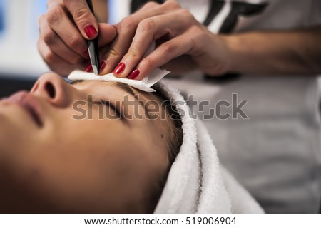 eyebrows treatment in a wellness center #519006904