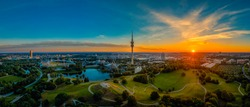Eyecatching sunrise view over Munich at a wonderful morning at a summer day as panorama.
