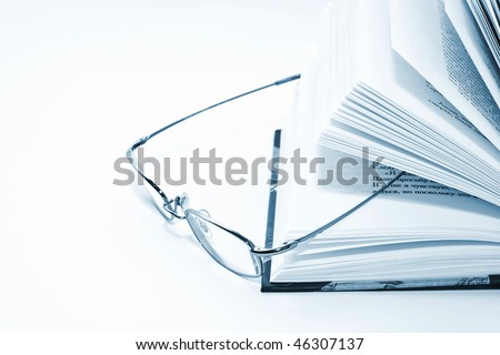 Eyeglasess and open book