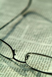 eyeglasses lying on a (german) newspaper, shallow DoF