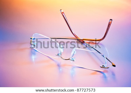 eyeglasses with reflection in mixed light