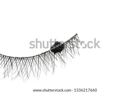 Eyelashes with mascara strokes on white background #1336217660