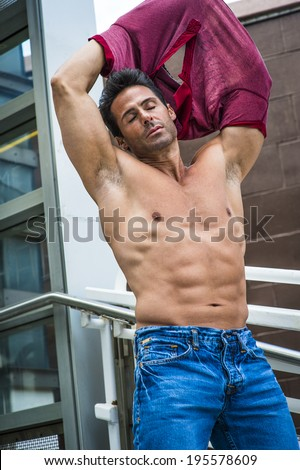 stock-photo-eyes-closed-arms-raised-a-handsome-sexy-middle-age-man-is-taking-off-his-shirt-showing-his-195578609.jpg