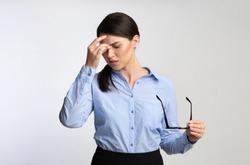 Eyes Fatigue. Overworked Businesswoman Massaging Nosebridge Having Migraine Or Ocular Hypertension Over White Studio Background.