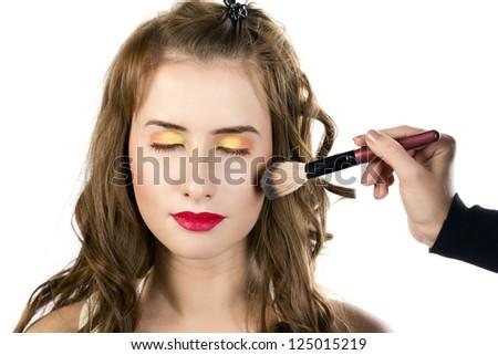 Eyes Makeup.Make-up.Eyes shadows. Brush for blush, Powder brush. Makeup artist apply makeup