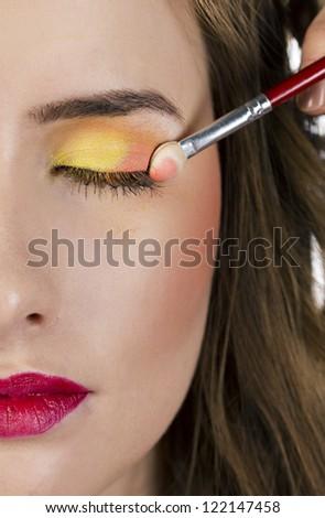 Eyes Makeup.Make-up.Eyes shadows. Eye shadow brush. Makeup artist apply makeup
