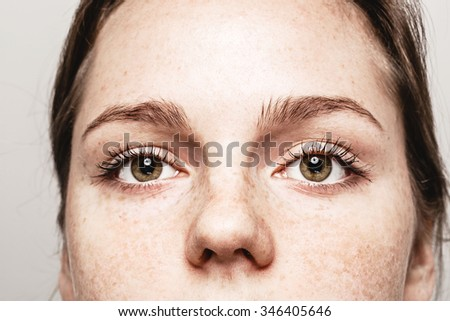 Eyes nose woman Young beautiful freckles woman face portrait with healthy skin - Shutterstock ID 346405646