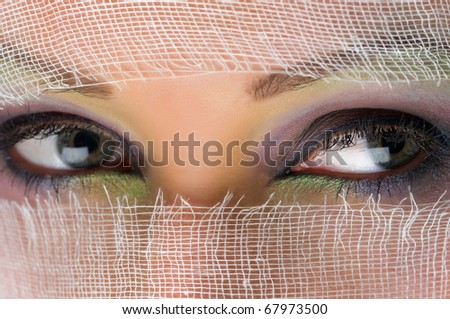 Eyes of a beautiful young woman wearing makeup bright