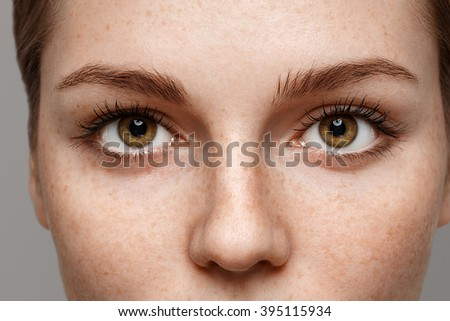 Eyes woman close-up freckles face - Shutterstock ID 395115934