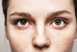 Eyes woman Young beautiful freckles woman face portrait with healthy skin