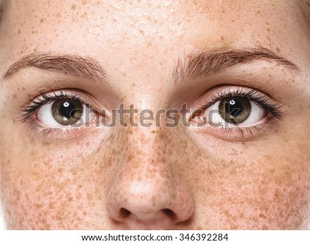 Eyes Young beautiful freckles woman face portrait with healthy skin - Shutterstock ID 346392284