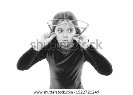Eyesight and eye health. Improve eyesight. Girl kid wear big eyeglasses isolated white background. Optics and eyesight treatment. Effective exercise eyes zooming. Child happy with good eyesight.