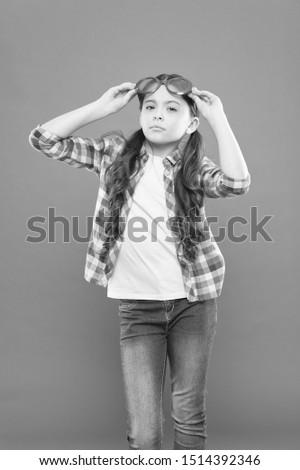 Eyesight and eye health. Improve eyesight. Girl wear eyeglasses. Ultraviolet protection crucial while polarization more preference. Optics and eyesight treatment. Child happy with good eyesight.