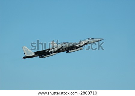 F-15 Eagles taking off in formation against blue sky