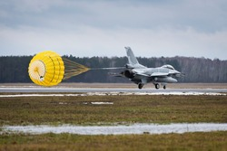 F16 fighter jet landing with open parachute in poland during pre