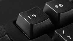 F5 key, computer keyboard background and texture, side view