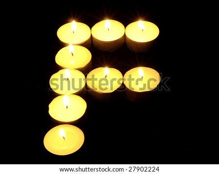 f letter made of candles