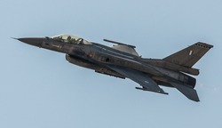 F16 military fighter jet flying