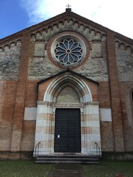 Façade of the church of Santa Maria del Gradaro, a religious building of medieval origin in Romanesque Gothic style on the outskirts of the city of Mantua.