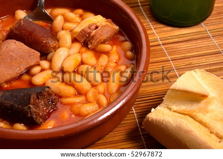 Fabada stew, regional Spanish cusine served in traditional clay casserole