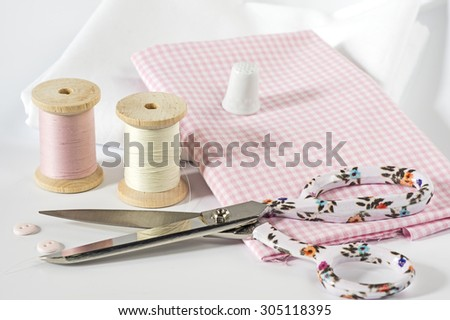 Fabric and sewing tools in pink #305118395
