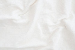 Fabric backdrop White linen canvas crumpled natural cotton fabric Natural handmade linen top view  background  Organic Eco textiles White Fabric texture