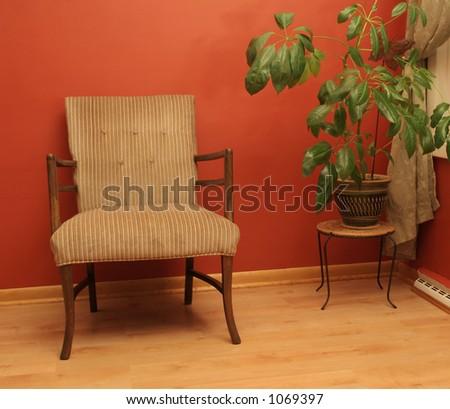 Fabric chair on wood flooring near window