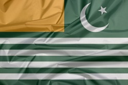 Fabric flag of Azad Kashmir state flag. Green background with four white stripes; a gold canton and a star and crescent.