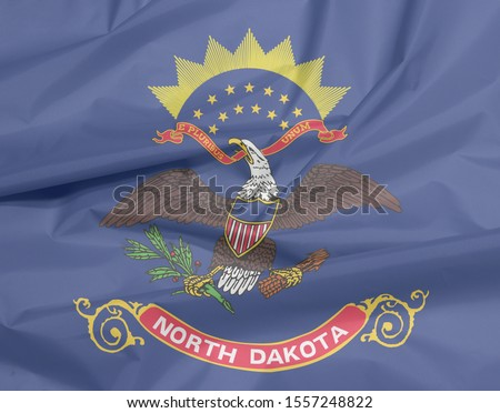 Fabric flag of North Dakota. Crease of North Dakota flag background, the states of America. Flag of the unit by state troops in the Philippine-American War.